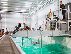 Engineers conducting researcher in the wave tow flume.