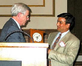 Rajiv Parikh receiving an award