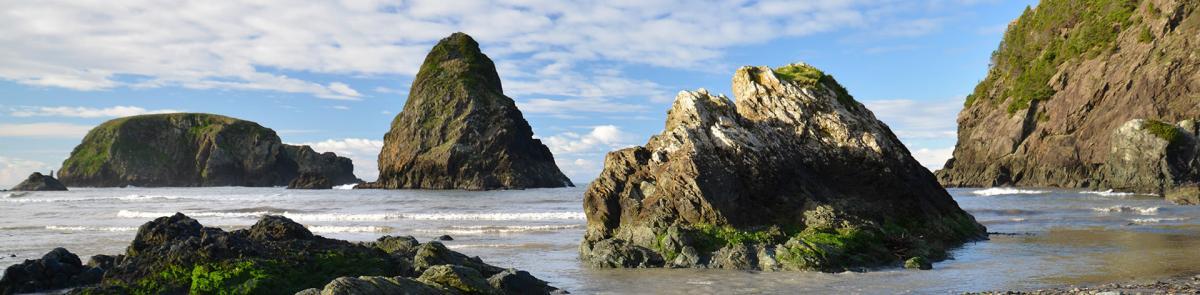 rock islands protruding from ocean shore