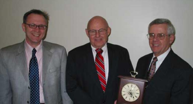 John Olson receiving an award