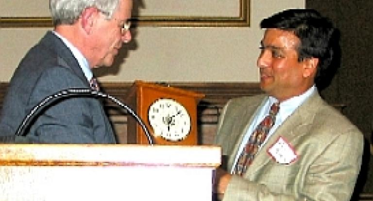 Rajiv Parikh receiving an award