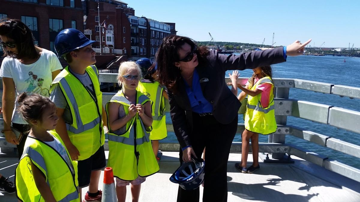 dr bell with young students at memorial bridge