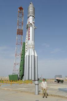 man next to rocket